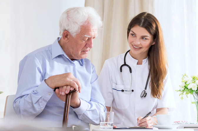healthcare staff talking with the old man