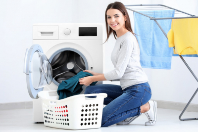 young lady doing laundry