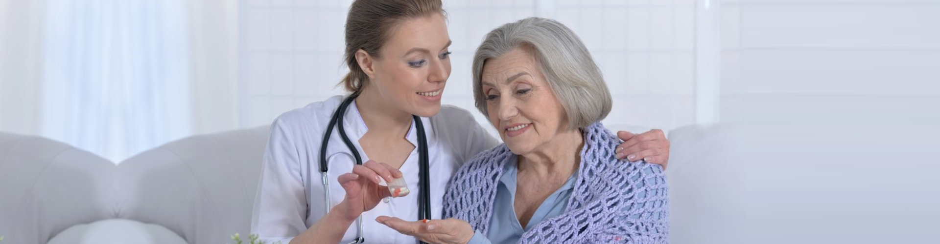 lady healthcare talking with the old woman