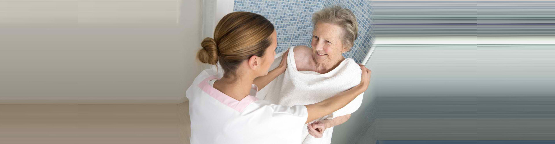 lady caregiver assisting the old woman